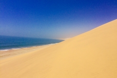 SAND DUNES MEET THE SEA, NAMIBIA
